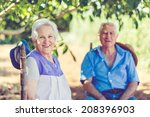 aged couple is sitting under a... | Shutterstock . vector #208396903