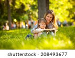 mother and daughter reading a... | Shutterstock . vector #208493677