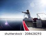 fishing man in boat | Shutterstock . vector #208628293