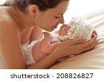 mother and her newborn baby.... | Shutterstock . vector #208826827