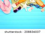 few summer items on wooden... | Shutterstock . vector #208836037