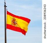 flying spain flag over sky... | Shutterstock . vector #208936243