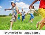 kids in motion of running on... | Shutterstock . vector #208962853