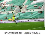Small photo of Wroclaw. POLAND - August 3: Match T-Mobile Ekstraklasa between Wks Slask Wroclaw and Zawisza Bydgoszcz. Goalkeeper Andrzej Witan with flying reaction on August 3, 2014 in Wroclaw. Poland.