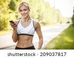 young lady running on a rural... | Shutterstock . vector #209037817