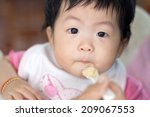 mother feeding happy little... | Shutterstock . vector #209067553