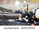 biker hand rests on the... | Shutterstock . vector #209215933
