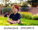 7 year old boy playing outside... | Shutterstock . vector #209238973
