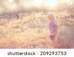 Cute Kid Walking In Field And...