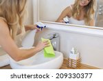 Blonde Young Woman Cleaning...