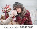beautiful girl in the park in... | Shutterstock . vector #209392483