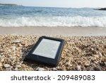 e book reader on a beach with...   Shutterstock . vector #209489083