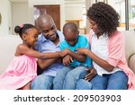 happy family relaxing on the... | Shutterstock . vector #209503903