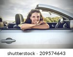 beautiful young woman in a... | Shutterstock . vector #209574643