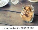 Brown Sugar In Bottle On Wood...