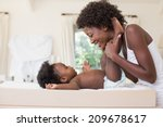happy mother with baby girl on... | Shutterstock . vector #209678617