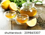 green tea in cup and teapot on... | Shutterstock . vector #209865307