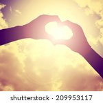 Two Hands Making A Heart Shap...