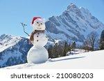 snowman against alpine panorama  | Shutterstock . vector #210080203