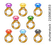 set of gold rings with colorful ...