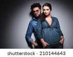 cool young couple standing... | Shutterstock . vector #210144643