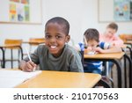 disabled pupil writing at desk... | Shutterstock . vector #210170563