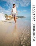 woman on the beach | Shutterstock . vector #210177787