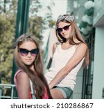 two young girl friends sitting... | Shutterstock . vector #210286867