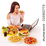 woman eating fast food at work. ... | Shutterstock . vector #210302773