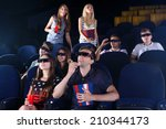 young people watching movie in... | Shutterstock . vector #210344173