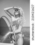 beautiful girl on the yacht   Shutterstock . vector #210421627