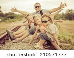 happy family sitting on the... | Shutterstock . vector #210571777
