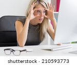 tired woman in front of computer | Shutterstock . vector #210593773