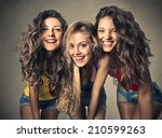 three young women that are... | Shutterstock . vector #210599263