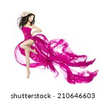 Stock photo woman dancing in fluttering dress fashion model dancer with waving fabric isolated white 210646603