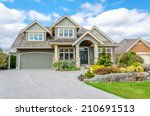 luxury house with a two car... | Shutterstock . vector #210691513