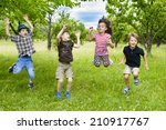 kids jumping in a orchard... | Shutterstock . vector #210917767