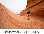 hiker in the coyote butte... | Shutterstock . vector #211137877