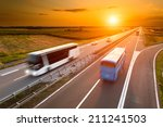 two buses on highway in motion