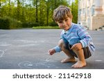 4 year old boy draws with chalk ... | Shutterstock . vector #21142918