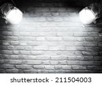 dark background with spotlights  | Shutterstock . vector #211504003