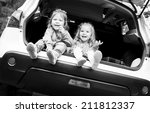 two happy kids in the car   ... | Shutterstock . vector #211812337