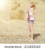 young blonde autumn field sun | Shutterstock . vector #211833163