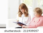 female doctor consulting with...   Shutterstock . vector #211939057