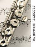 Worn Flute On Sheet Music