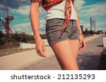 a young woman wearing short... | Shutterstock . vector #212135293
