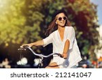 beautiful woman riding on bike | Shutterstock . vector #212141047