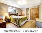 bedroom with wooden furniture... | Shutterstock . vector #212256997