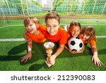 happy kids laying on grass with ... | Shutterstock . vector #212390083
