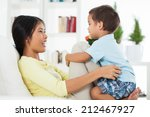 loving mother playing with her... | Shutterstock . vector #212467927